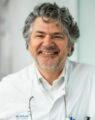 Dr. Jan De Neve
